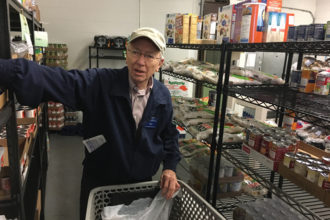 Ken Kirn, stocked shelves at the Society of St. Vincent de Paul Food Pantry March 7. For this and other service, he received the society's Top Hat Award. (Photo Special to The Record)