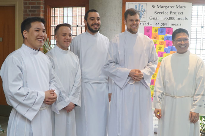 Deacons Minh Vu, Brandon DeToma, Robert Barnell, David Farrell and Kien Nguyen share a light moment prior to their transitional diaconate ordination March 25 at St. Margaret Mary Church. The transitional diaconate typically takes one year prior to ordination to the priesthood. (Record Photos by Jessica Able)