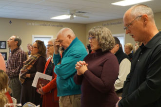 Parishioners of Our Lady of the Caves Church in Horse Cave, Ky., attended a Mass Dec. 11, 2016, in the parish hall. The church building caught fire in the early morning of Dec. 9. The parish, located in Hart County, is beginning the rebuilding process. (Record File Photo by Ruby Thomas)