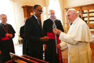 Pope Francis accepts a gift from Rwandan President Paul Kagame during a private meeting at the Vatican. (CNS photo/Tony Gentile, pool via EPA)