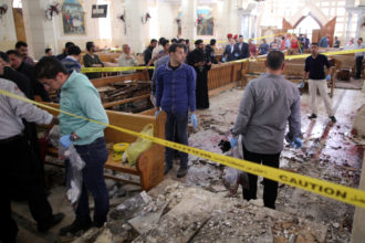 Security personnel investigate the scene of a bomb explosion on April 9 inside the Orthodox Church of St. George in Tanta, Egypt. That same day an explosion went off outside the Cathedral of St. Mark in Alexandria where Coptic Orthodox Pope Tawadros II was presiding over the Palm Sunday service. (CNS photo/Khaled Elfiqi, EPA)