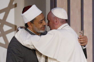 Pope Francis embraces Sheik Ahmad el-Tayeb, grand imam of al-Azhar University, at a conference on international peace in Cairo April 28. The pope was making a two-day visit to Egypt. (CNS photo/Paul Haring)