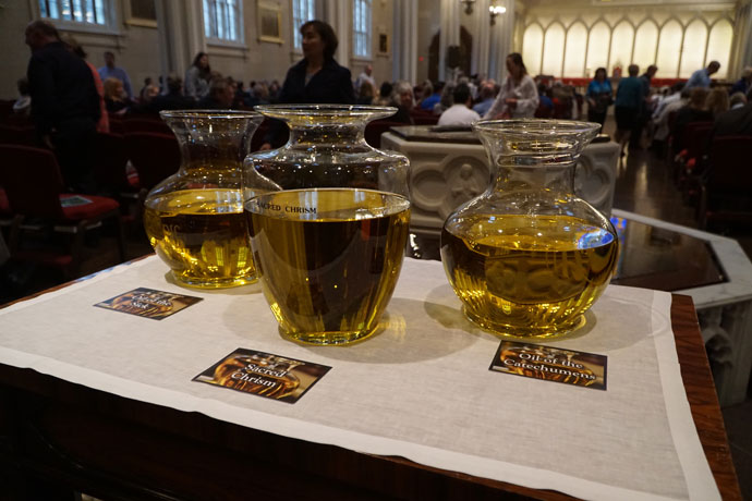 Archbishop Joseph E. Kurtz blessed the oil of the sick and the oil of the catechumens and consecrated the sacred chrism at the annual Chrism Mass April 11 at the Cathedral of the Assumption. (Record Photos by Jessica Able)