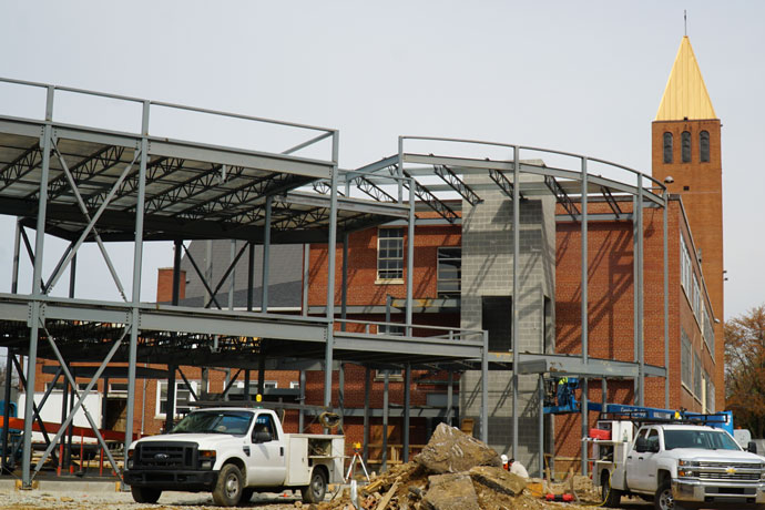 Equipment, building debris and support for part of the new Archdiocese of Louisville Pastoral Center are seen from Poplar Level Road March 30. The tower of Holy Family Church rises above the building site, which occupies the former school and preschool of Holy Family and adjacent land on the church property. (Record Photo by Marnie McAllister)