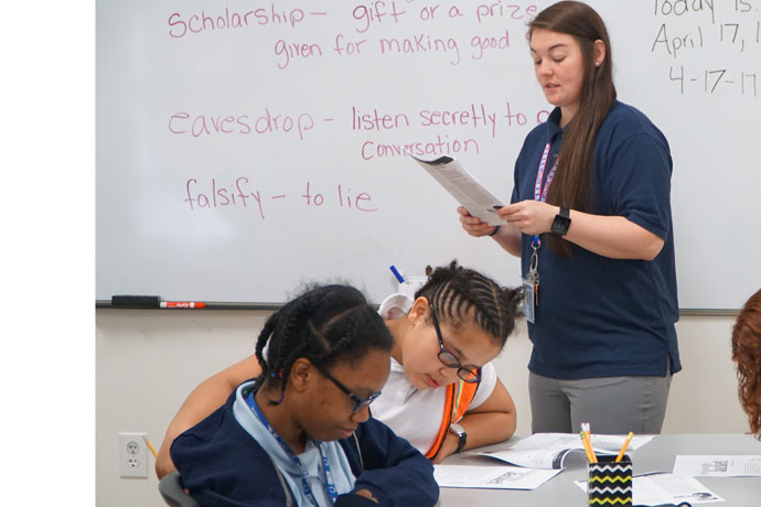 Polly West, a teacher's assistant at Pitt Academy, 7515 Westport Road, read to students in a study skills class April 17. Kosair Charities donated a $1 million to the school on April 11. (Record Photo by Ruby Thomas)