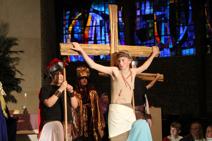 St. James School in Elizabethtown, Ky., performed the annual Passion play on Holy Thursday, April 13. Jesus, portrayed by Matthew Barnes, is shown in the last moments before his death on the cross, above right. (Photo Special to The Record)
