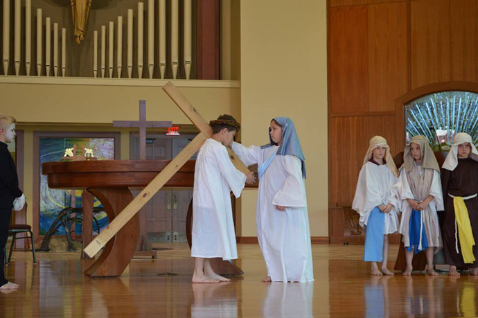 Third-grade students at St. Michael School acted out the Living Stations of the Cross on Good Friday, April 14. Jesus, played by Luka Bentz, meets his mother Mary, played by Madison Humphrey, above, in a scene depicting the fourth station. (Photo Special to The Record)