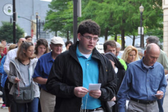 About 75 people, including Archbishop Joseph E. Kurtz, prayed the rosary during a procession to an abortion clinic in downtown Louisville May 20, as part of the Helpers of God's Precious Infants monthly prayer vigil for life at the Cathedral of the Assumption. The Helpers marked its 10th anniversary with Mass prior to the procession.  (Record Photo by Jessica Able)