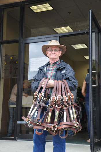 Pat Day, Hall of Fame jockey, holds harnesses with the names of the 2017 Kentucky Derby contenders April 27. Day is president of the Kentucky Race Track Chaplaincy, which ministers to horsemen on the backside of Churchill Downs.