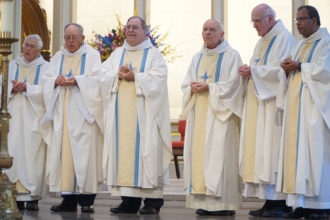Priests celebrating jubilee years of their ordinations concelebrated Mass at the Cathedral of the Assumption May 23. Among them are, from left, Fathers Robert B. Gray, Bernard L. Craycroft, G. Nicholas Rice, Joseph T. Merkt, Donald W. Springman and Saju Vadakumpadan. (Record Photo by Ruby Thomas)