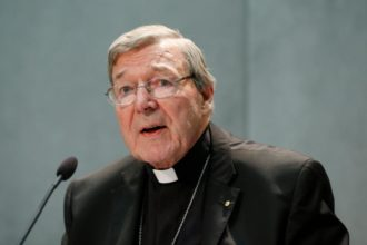 Australian Cardinal George Pell delivers a statement in the Vatican press office June 29. Speaking after Australian authorities filed sexual abuse charges against him, the cardinal denied all charges and told reporters he looks forward to having an opportunity to defend himself in court. (CNS photo/Paul Haring)