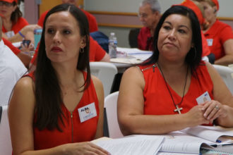 Alba Martín, left, and Mary Coadros listened during a presentation at the first parish Encuentro held June 25 at St. James Church in Elizabethtown, Ky. (Record Photo by Ruby Thomas)