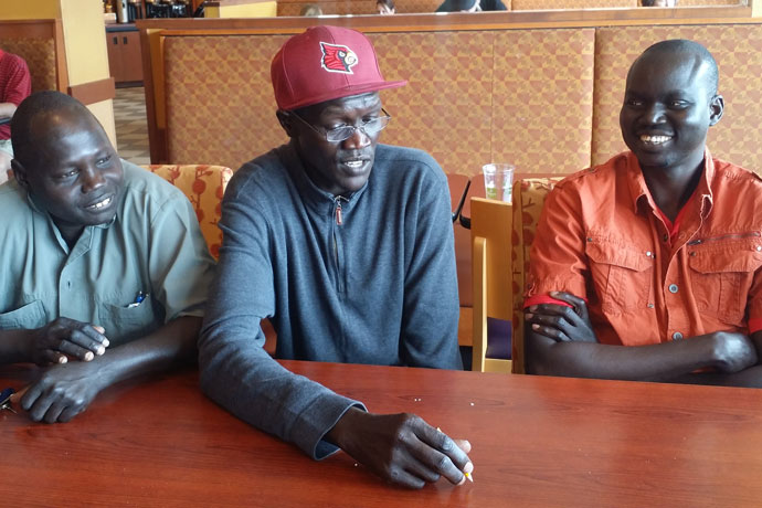 """Once known as """"Lost Boys,"""" from left, Ngor Deng, Anyuon Agoth Manyuon and Ngong Lang Deng talked about their native Sudan at Panera Bread on Dutchman's Lane May 27. When the men and thousands of other children fled a civil war in 1989, they became known as the """"Lost Boys of Sudan."""" (Record Photo by Ruby Thomas)"""
