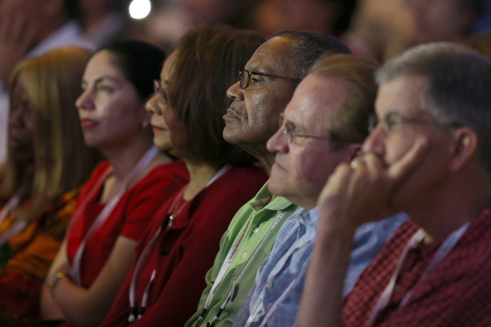 "Archdiocese of Louisville delegates, from left, M. Annette Mandley-Turner, Eva Gonzalez, Janie Henderson, Robert Henderson, Deacon Lucio Caruso and Ed Harpring, listened during a presentation at the ""Convocation of Catholic Leaders: The Joy of the Gospel in America,"" which took place in Orlando, Fla., July 1-4. (CNS Photo by Bob Roller)"
