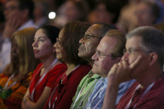 """Attendees listen to the homily during the opening Mass of the """"Convocation of Catholic Leaders: The Joy of the Gospel in America"""" July 1 in Orlando, Fla. Leaders from dioceses and various Catholic organizations are gathering for the July 1-4 convocation. (CNS photo/Bob Roller)"""