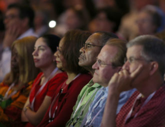 "Attendees listen to the homily during the opening Mass of the ""Convocation of Catholic Leaders: The Joy of the Gospel in America"" July 1 in Orlando, Fla. Leaders from dioceses and various Catholic organizations are gathering for the July 1-4 convocation. (CNS photo/Bob Roller)"