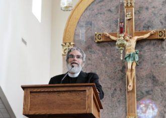 Jesuit Brother Guy Consolmagno, director of the Vatican Observatory, urged an audience at Sts. Peter and Paul Church in Hopkinsville, Ky., Aug. 20 that celestial events such a total solar eclipse are a wonder of God's creation meant to be enjoyed. Brother Consolmagno was in Hopkinsville to view the Aug. 21 eclipse. (CNS photo/Dennis Sadowski)