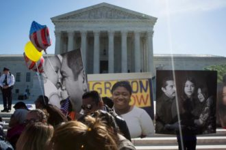 Supporters of the Deferred Action for Childhood Arrivals program, known as DACA, are seen outside the U.S. Supreme Court in Washington last year. (CNS photo/Tyler Orsburn) See ACCU-PRESIDENTS-SUPPORT-STUDENTS Nov. 30, 2016.