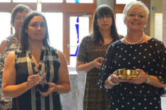 Teachers served as gift bearers during the annual Mass for educators held  at St. Margaret Mary Church, 7813 Shelbyville Road, on Aug. 11. (Record Photo by Ruby Thomas)