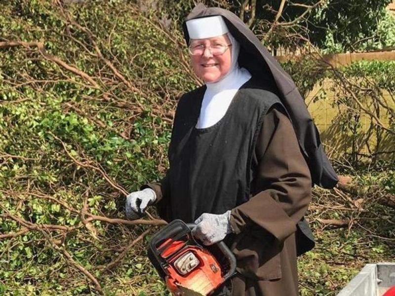 Chainsaw-Wielding Nun Cleaning Up After Hurricane