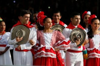 Colombian dancers in traditional dress wait for Pope Francis upon his arrival in Bogota, Colombia, Sept. 6. (CNS photo/Paul Haring)