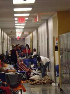 People bed down in the hallways of Largo High School in Largo, Fla., as they await Hurricane Irma Sept. 10. (CNS photo/Mickey Conlon)