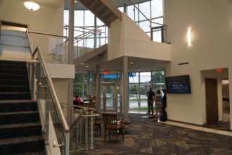 The lobby of the new Archdiocese of Louisville Pastoral Center, 3940 Poplar Level Road, is seen from the rear entrance. The main entrance, visible in the right half of the photo, faces Poplar Level. (Record Photo by Marnie McAllister and Jessica Able)