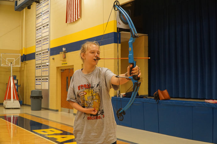Faith Oakley shot several practice arrows in the Bethlehem High School gymnasium Aug. 21. The Bethlehem junior has Erb–Duchenne palsy stemming from a birth injury and lacks the use of her right arm. She shoots using a special mouthpiece. Oakley placed ninth among high school girls in the National Archery in the Schools Program World Tournament held in Orlando, Fla., July 21-22. (Record Photos by Jessica Able)