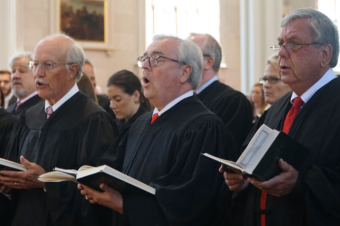 Judges sang during the Red Mass celebrated by Archbishop Joseph E. Kurtz at the Cathedral of the Assumption Sept. 8. The Red Mass invokes God's blessing and guidance on those who work in the legal profession. (Record Photo by Ruby Thomas)