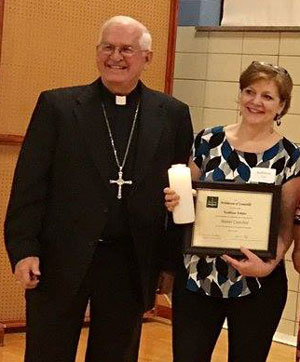 Kathy Fehder, principal of Corpus Christi Classical Academy, is pictured with Archbishop Joseph E. Kurtz after receiving a master catechist certificate at the Sept. 27 Faith Formation Celebration. (Photo Special to The Record)