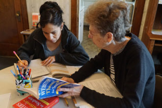 Sister Ruth Ann Humphrey, one of Doors to Hope's first volunteers, tutored Rocio Murillo, a native of Tijuana, Mexico, Oct. 12. Murillo is preparing to test for her General Equivalency Diploma (GED). Record Photo by Ruby Thomas