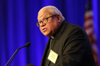 Bishop George V. Murry of Youngstown, Ohio, chair of the U.S. bishops' Ad Hoc Committee Against Racism, speaks Nov. 13 during the fall general assembly of the U.S. Conference of Catholic Bishops in Baltimore. (CNS photo/Bob Roller)