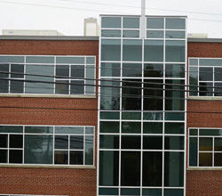 Triple-paned windows of the new Pastoral Center are seen from Poplar Level Road. The windows are both designed to reduce noise and to minimize extreme lighting conditions. (Record Photo by Marnie McAllister)