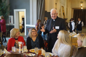 Archbishop Joseph E. Kurtz talks with Shirley Day and Anna Meade, teachers at St. Michael, and Connie Shellhamer, a teacher at Holy Spirit, from left, at the annual teacher appreciation luncheon Nov. 8 held at The Olmsted. (Record Photo by Jessica Able)