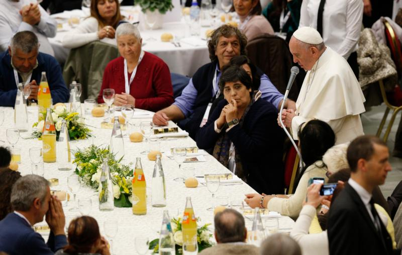 Pope Francis leads grace before eating lunch with the poor in the Paul VI hall after celebrating Mass marking the first World Day of the Poor at the Vatican Nov. 19. Some 1,200 poor people joined the pope for the meal. (CNS photo/Paul Haring)