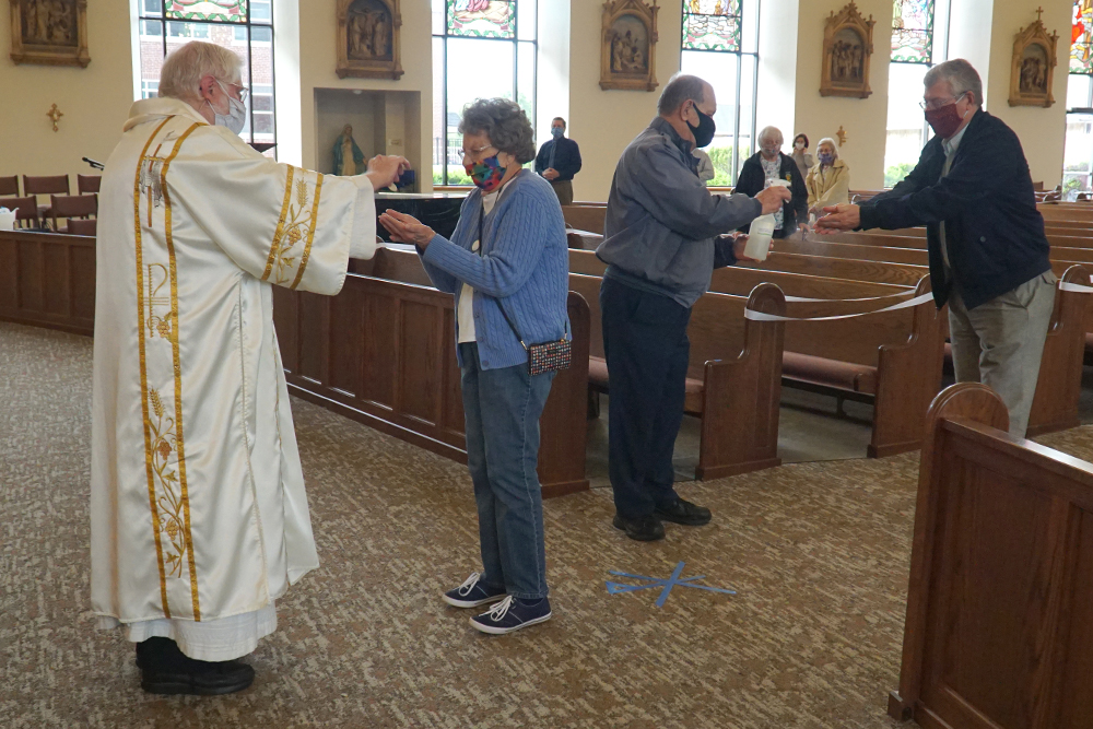 Parishes in the Archdiocese of Louisville will continue to hold Masses with restrictions
